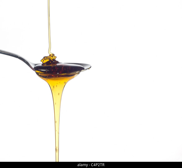 pouring honey - Stock Image