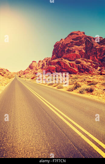 Vintage toned desert highway, travel concept, USA. - Stock-Bilder