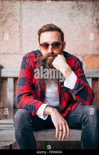 Portrait of man with beard wearing sunglasses - Stock-Bilder