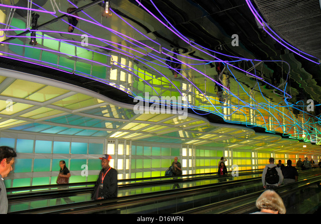 Illinois Chicago O'Hare International Airport ORD concourse moving sidewalk walkway conveyor light show neon - Stock Image