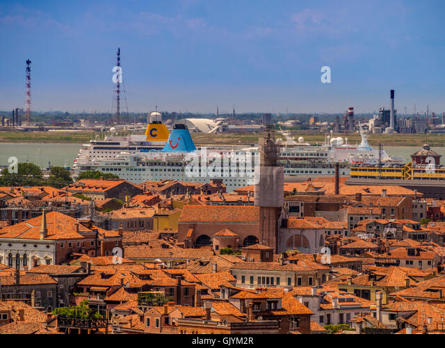 Aerial view of Venice rooftops with 2 cruise liners in the distance, Venice, Italy. - Stock Image