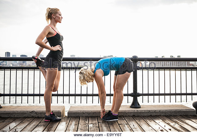 Women stretching on bridge, Montreal, Quebec, Canada - Stock Image