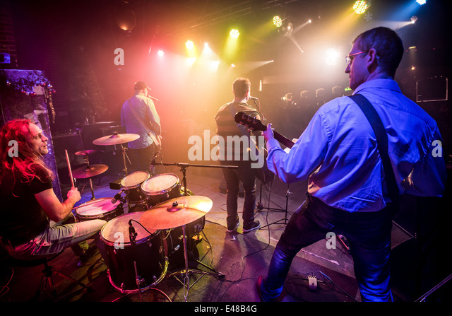 Band performs on stage, rock music concert - Stock-Bilder