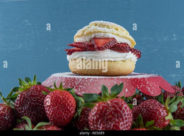 Strawberry Shortcake with Fresh Berries surrounding tray - Stock Image