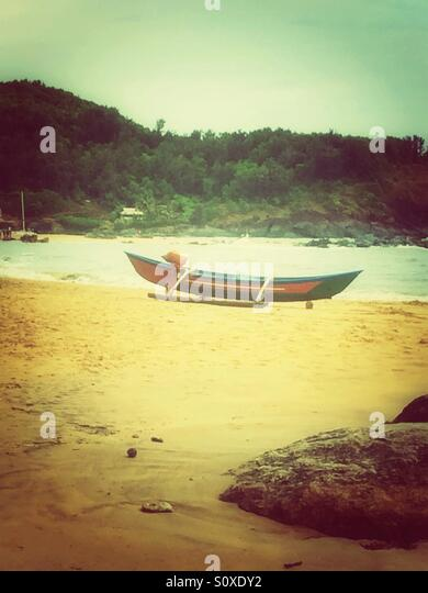 A boat on the beach - Stock Image