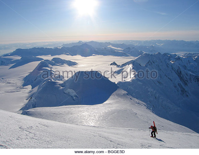 A ski mountaineer ascends the upper reaches of Mount Marcus Baker, the highest peak in the Chugach mountains, in - Stock Image