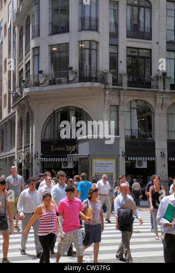 Buenos Aires Argentina Avenida de Mayo downtown street scene Confitería London City corner busy crowded crossing - Stock Image