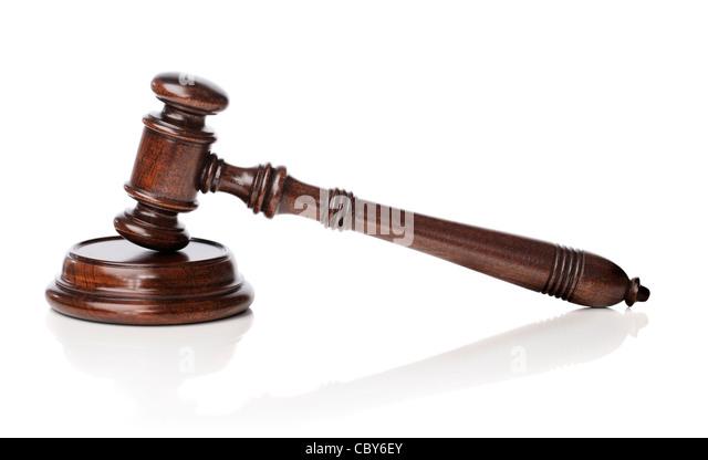 Wooden mahogany gavel with sounding block on white reflective background. - Stock Image