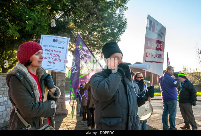 UNISON, UNITE & RCN members hold up placards saying outside Wonford House at the Royal Devon & Exeter Hospital - Stock Image