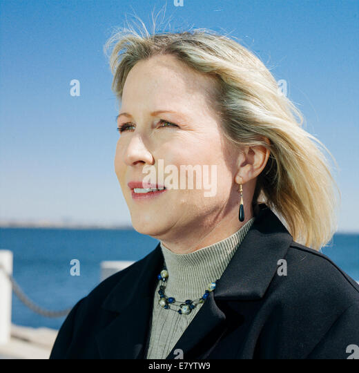 Portrait of middle-aged woman on promenade - Stock Image