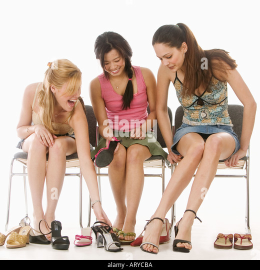 Young women trying on shoes - Stock Image