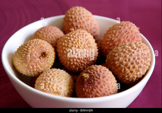 Fresh lychees in a bowl - Stock Image