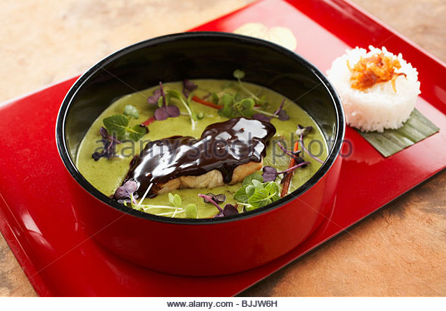 Green fish curry with chocolate glaze - Stock Image