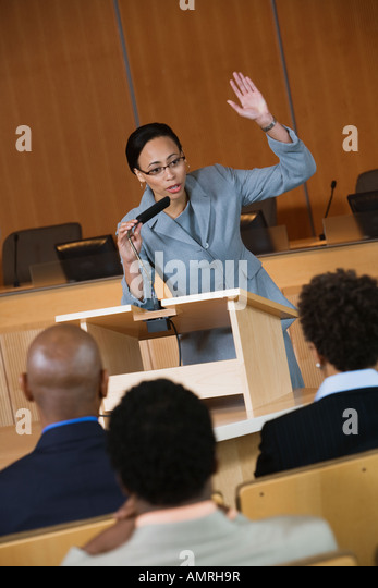 African businesswoman giving lecture - Stock Image