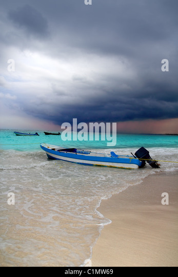 Caribbean before tropical storm hurricane beach boat dramatic scenics - Stock Image