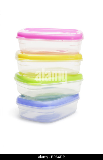 Stack of four plastic storage containers on white background - Stock Image