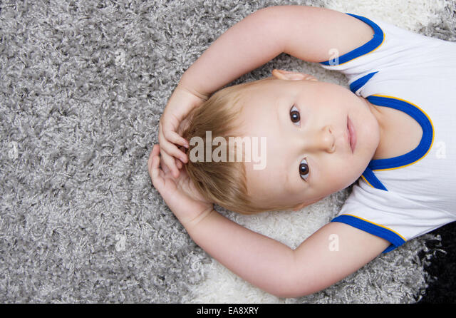 cute baby lying on back - Stock Image