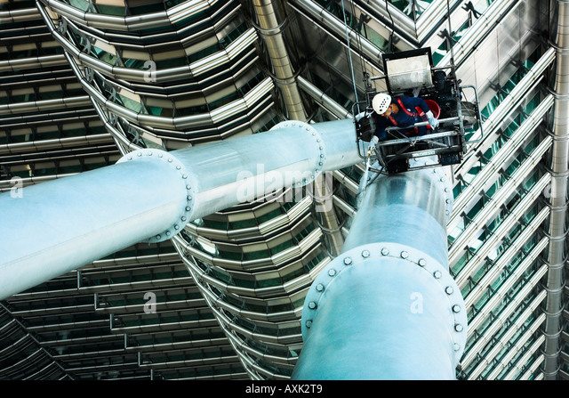 business working new city skyscraper building windowns office lines angles round fall man pipe build construction - Stock Image