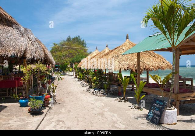 Beach loungers on Gili Air island, Indonesia. - Stock Image