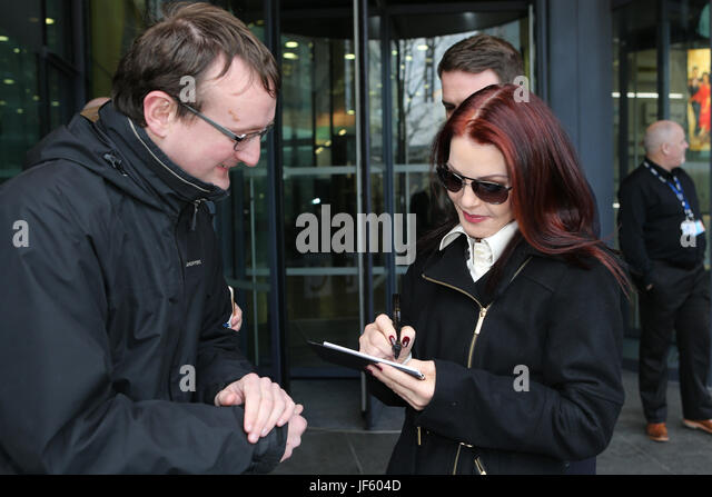 Priscilla Presley leaving 'BBC Breakfast' studios after her appearance on the show. - Stock Image