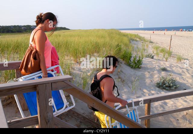 Massachusetts Cape Cod Nauset Beach Cape Cod National Seashore dune grass sunbathers man woman Atlantic Ocean - Stock Image