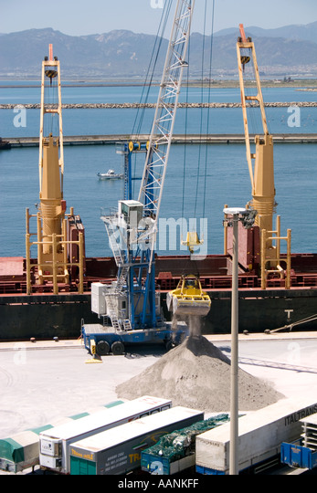 truck lorry wait waiting at Cagliari Port Sardinia truck lorry harbour harbor dock dockside crane boat ship cargo - Stock Image
