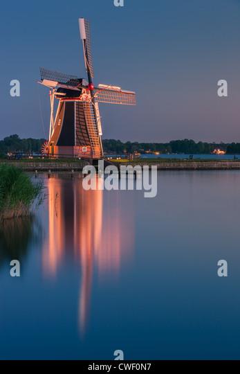 Windmill De Helper at Paterswoldsemeer just after sunset, near Haren in the Province of Groningen, Netherlands - Stock-Bilder