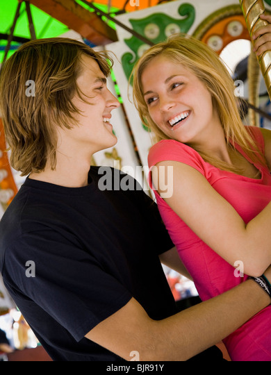 young couple at an amusement park - Stock Image