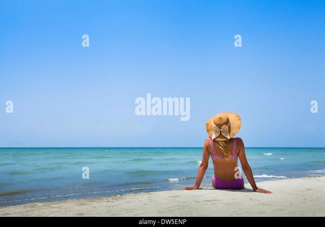 woman in bikini on the beach - Stock Image