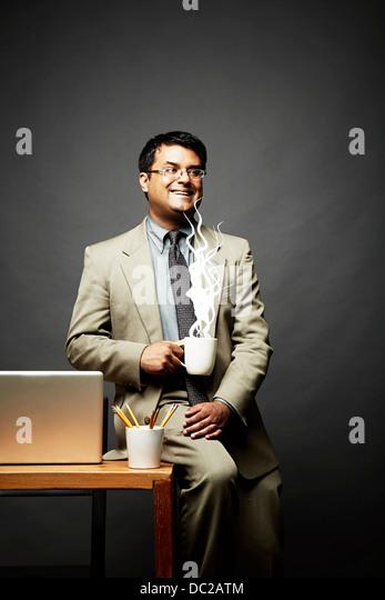 Man enjoying hot drink - Stock-Bilder