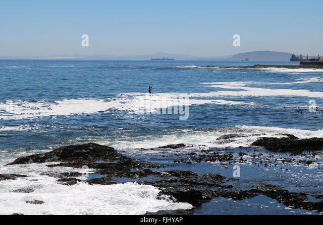 Stand up paddle boarder, Sea Point, Cape Town, South Africa - Stock Image