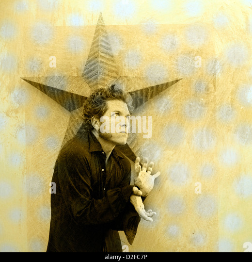 Alternative version of an innocent saying 'catch a falling star...' Man with star. Photo based illustration. - Stock Image