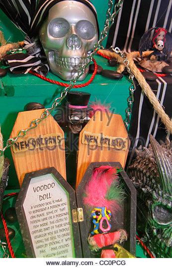Louisiana New Orleans Canal Street downtown business store window novelties masks souvenirs voodoo doll skull casket - Stock Image