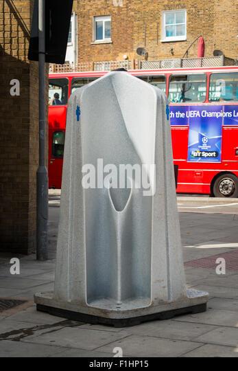London , Chalk Farm , Camden Town , public non screened portable male men's wc convenience urinal pissoir vespasienne - Stock Image