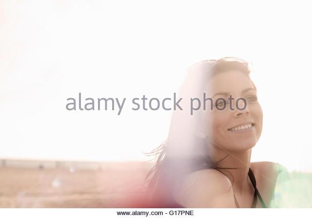 Young woman with long brown hair on beach, Santa Monica, California, USA - Stock Image