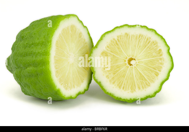 Kaffir lime half and round slice macro on a white background - Stock Image