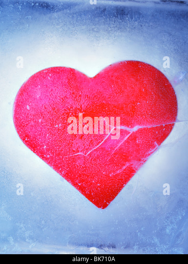 A Red heart frozen in a block of ice - Stock Image