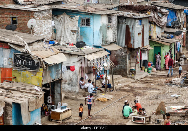 Mumbai India Asian Dharavi Shahu Nagar slum shanties high population density poverty residents low income poor - Stock Image