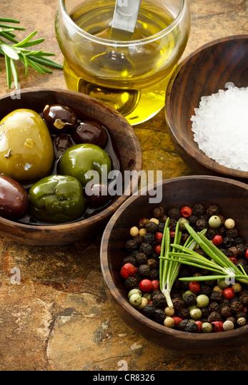 Olive oil, peppercorn, sea salt on stone table - Stock-Bilder
