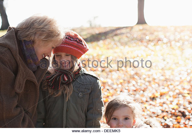 Family smiling  outdoors in autumn - Stock Image