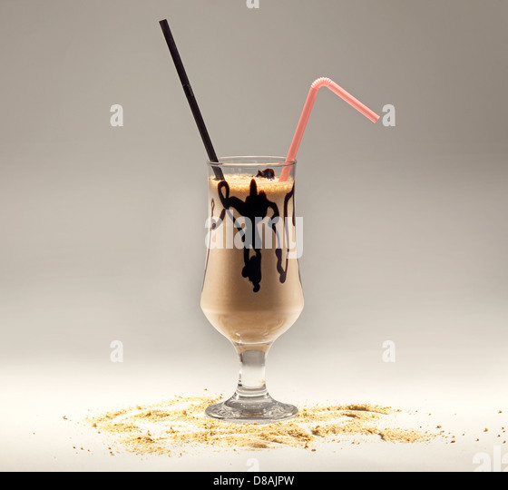 Chocolate cup, in a glass, studio isolated. - Stock Image