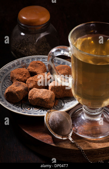 Tea and chocolate candies in a vintage style - Stock Image
