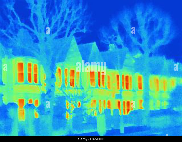 Thermal image of houses on city street - Stock Image