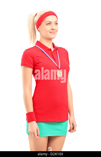 Winner female tennis player with a golden medal standing isolated on white background - Stock Image