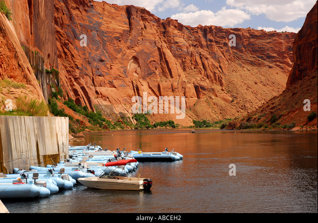 Arizona Glen Canyon white water rafts rafting Colorado River outdoor recreation red rock walls background - Stock Image