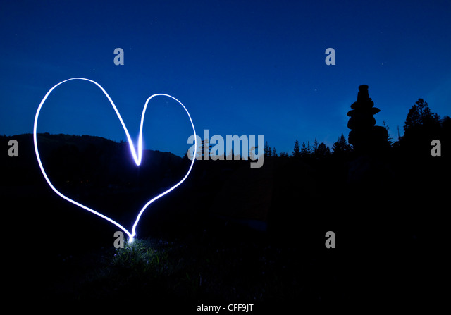 A light painting of a heart at sunset in Idaho. - Stock Image