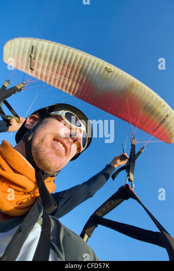 Tourist paragliding in San Gil, adventure sports capital of Colombia, San Gil, Colombia, South America - Stock Image