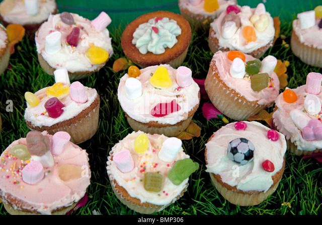Cupcakes on sale at Camden Green Fair, London - Stock Image