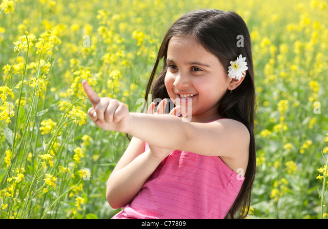 Young girl pointing - Stock Image