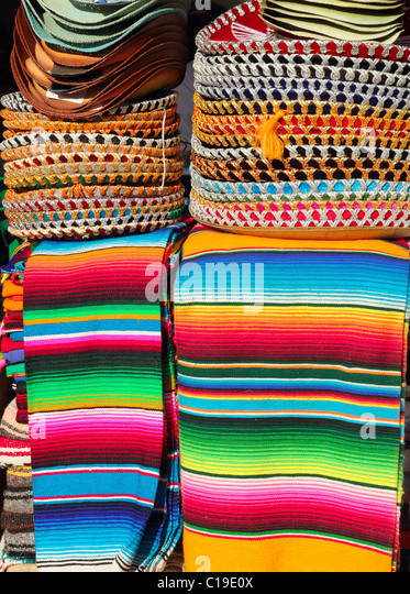 Mexican serape colorful stacked and charro hats mariachi - Stock Image